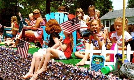 Float participants at Fourth of July parade.