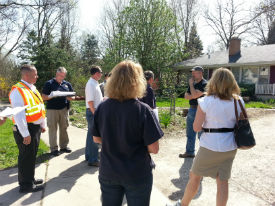 Officials discuss flood damage with a homeowner.