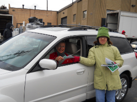 Volunteer Anna Cavallo hands out impaired driving literature at the March Electronics Recycling event.