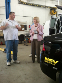 Fleet Manager Larry Humphries talks about the Village's green vehicles with Congresswoman Judy Biggert.