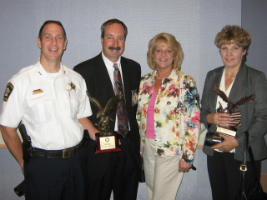 Deputy Chief Kurt Bluder, Chief Robert Porter, Mary Wennerstrom and Marion Heintz