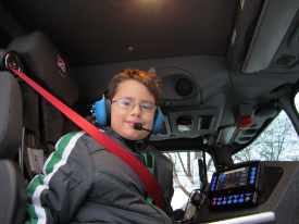 Lucas Marra at the helm of the fire truck.
